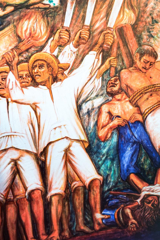 imagen que ilustra la guerra de castas del mural de Elio Carmichael